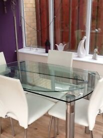 Extendable Glass dining table with 4 cream chairs