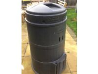 large black plastic compost bin