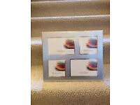 Photo Frame - new and Unused - Holds 4 photos