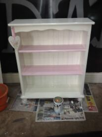 White and pink bookcase
