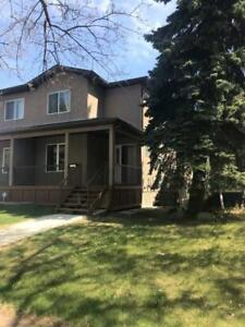Duplex with developed basement & detached garage in Inglewood