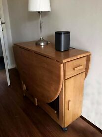 Debenhams Oak effect 'Stowaway' extending table and foldaway chairs ( Debenhams' price £275)