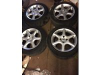 Mazda 323 set of alloy wheels and tyres