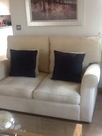 Two seater Collins and Hayes sofa in cream fabric. Very good condition