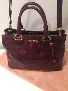 Miu Miu luxury wine color bag Silverwater Auburn Area Preview