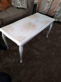 coffee table and 3 nest tables.