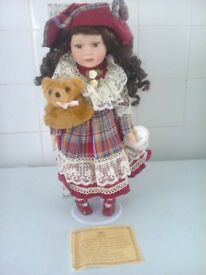 porcelain doll on a stand check dress holding bear name is susan