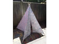 Beautiful handmade teepee with storage bag. Cotton with 4 sturdy dowel poles, use inside or out.