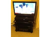 TV with sound bar and blue ray player, incl.stand