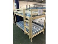 Brand new and boxed pine bunk bed with mattresses