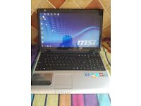 FAST MSI triple core laptop . win 7 . office , word etc . ideal present ..