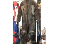 Leather one piece motorcycle suit.