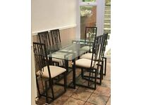 Glass/Metal dining room table and 6 metal chairs
