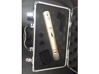 AKG C1000 S condenser microphone with case and stand.