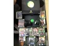 Xbox with 8 games