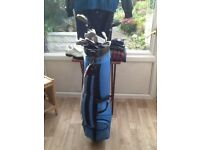 Golfers compleat set all that's needed clubs bag and much more .