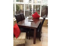 Dark wood dining table with 6 chairs. 4 leather 2wicker