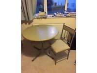 Circular dining table and 4 matching chairs
