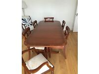 Dining table and 6 chairs which has been well looked after and looks lovely! It's made from yew.