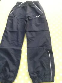 Nike navy track suit bottoms with zip leg cuffs, immaculate, 8-10 yrs