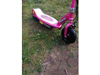 Child's pink electric scooter