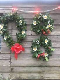 Holly wreaths Christmas trees and logs