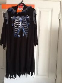 Halloween hooded outfit with mask and axe never been worn New with Tag Age 7- 8 Bargain