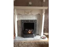 White fire surround and electric fire