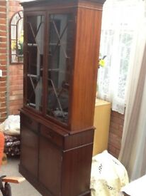 Display cabinet with cupboard below. Wood and glass. Very good condition. Free,buyer collects