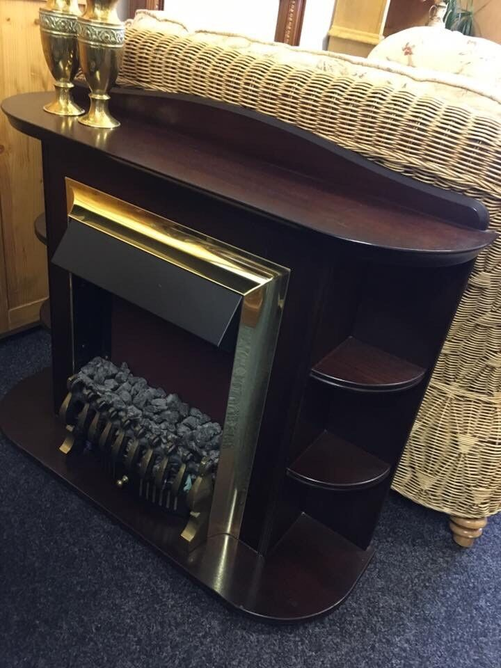 Electric fire and surround can deliver