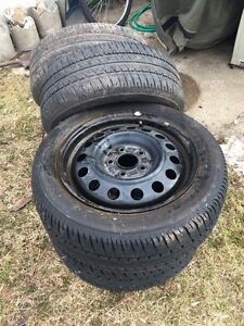 """3 good elantra tires 16"""" (4th busted, rim is good)"""