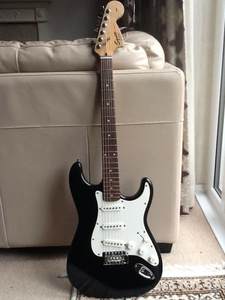 Fender Squire Stratocaster Electric Guitar with Fender SP10 Amplifier and Fender Guitar Bag