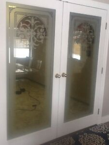 Solid wood doors w. Etches glass