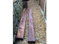 2 unused hard wood mid brown coloured railway type sleepers, perfect to make flower bed/ garden edge