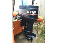 Yamaha 30hp 2 stroke auto lube outboard with new 703 remotes.