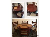 Large dark stained vintage style wooden table & 4 chairs legs unscrew for easy transport