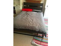 Double bed, bedside table and small wardrobe