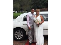 Beautiful full length ivory grecian style wedding dress in size 14/16