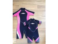 Two girls black and pink osprey wetsuits, size junior XS & 6-8