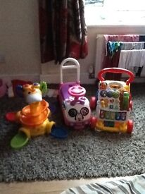 For sale, baby's sit + stand giraffe, vetech walker and mini mouse ride on car