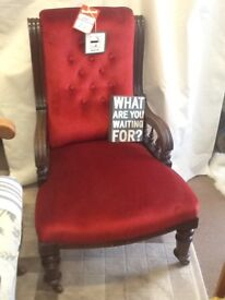 SMALL NURSING CHAIR NEWL UPHOLSTERED IN RED DRALON