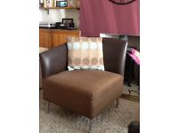 Brown faux leather corner chairs x2 can be put together to make sofa.