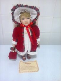 porcelain doll name is Lauren approx is 14 inch on stand in a box