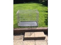 Dog Crate, L107, H 80, W 69. Sturdy and secure, folds down for storage. Suitable for car or home