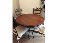Cast Iron/Wood Dining Table with 4 matching chairs.