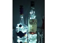 Bells Whisky and Courvoisier light up bottles