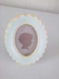 oval ceramic blue and cream free standing photo frame nice looking