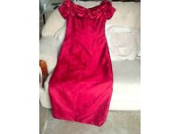 2 Beautiful red dresses size 10 and 12 used but in good condition.