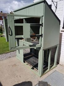 very large hutch and run ideal large to giants rabbits nearly 7ft tall and 6ft 9 across