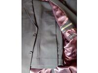 Mans grey pinstripe suit